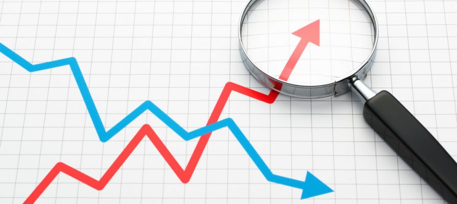 graph line trend analytics magnifying glass