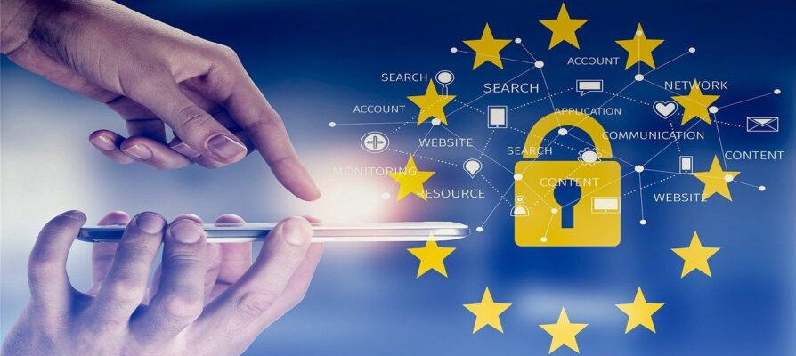 Mobile Phone and symbol of data protection in the internet